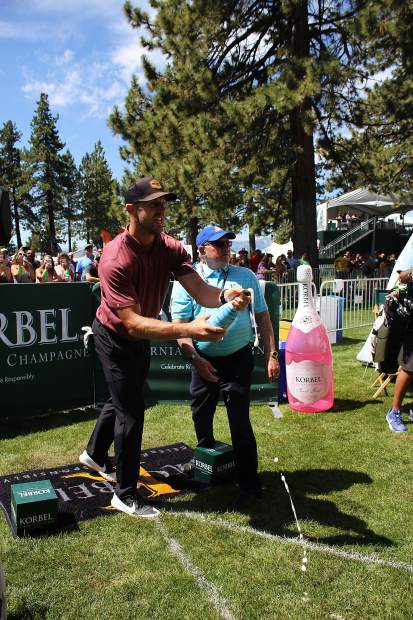 Alex Smith watches his shot at the Korbel Celebrity Spray-off.