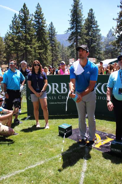 Aaron Rodgers watches his shot at the Korbel Celebrity Spray-off.