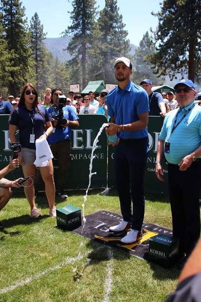 Stephen Curry watches his shot at the Korbel Celebrity Spray-off.