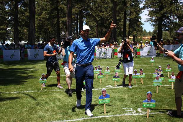 Stephen Curry celebrates his 63-foot shot, which put him in 1st place at the Korbel Celebrity Spray-off.
