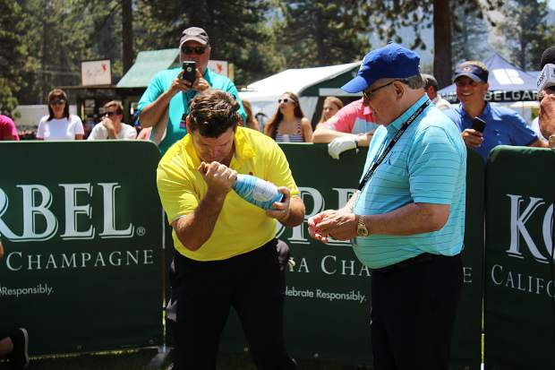 Bret Baier shakes a bottle of champagne at the Korbel Celebrity Spray-off.
