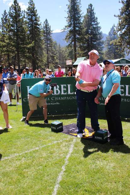 Roger Clemens watches his shot at the Korbel Celebrity Spray-off.