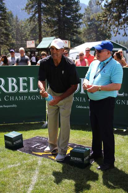 Herm Edwards attempts to improve upon his past scores at the Korbel Celebrity Spray-off.