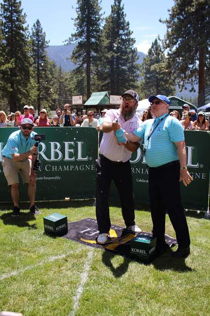 Willie Robertson attempts to launch a champagne cork at the Korbel Celebrity Spray-off.