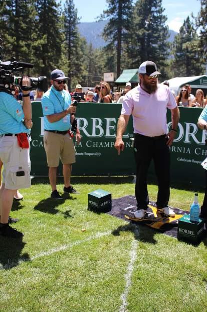 Willie Robertson's champagne cork falls to his feet.