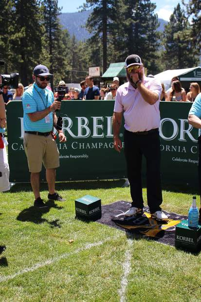 Willie Robertson laughs at his failed attempt at shooting the champagne cork at the Korbel Celebrity Spray-off.