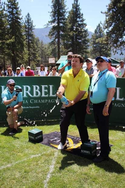 Bret Baier watches his shot at the Korbel Celebrity Spray-off.