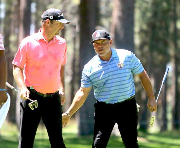 Ivan Rodriguez, right, tells Tim Wakefield good job during the final round of the American Century Championship on Sunday in Stateline.