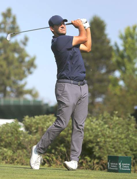 Tony Romo watches his opening tee shot during the final round of the American Century Championship on Sunday in Stateline.
