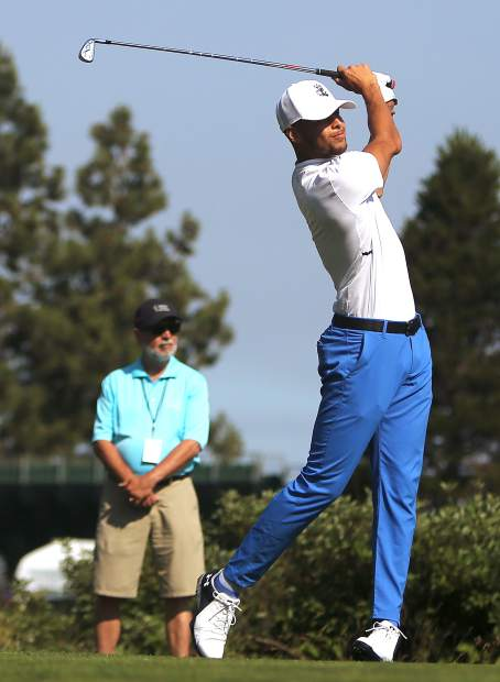 Steph Curry watches his tee shot during the final round of the American Century Championship on Sunday in Stateline.