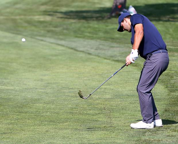 Tournament winner Tony Romo chips during the final round of the American Century Championship on Sunday in Stateline.