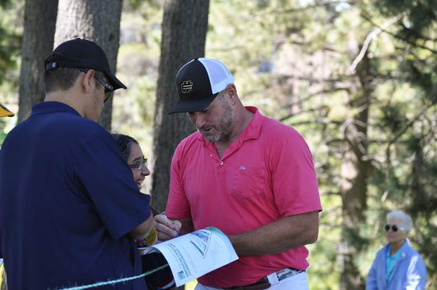 Former NFL quarterback Trent Dilfer signs an autograph Wednesday.