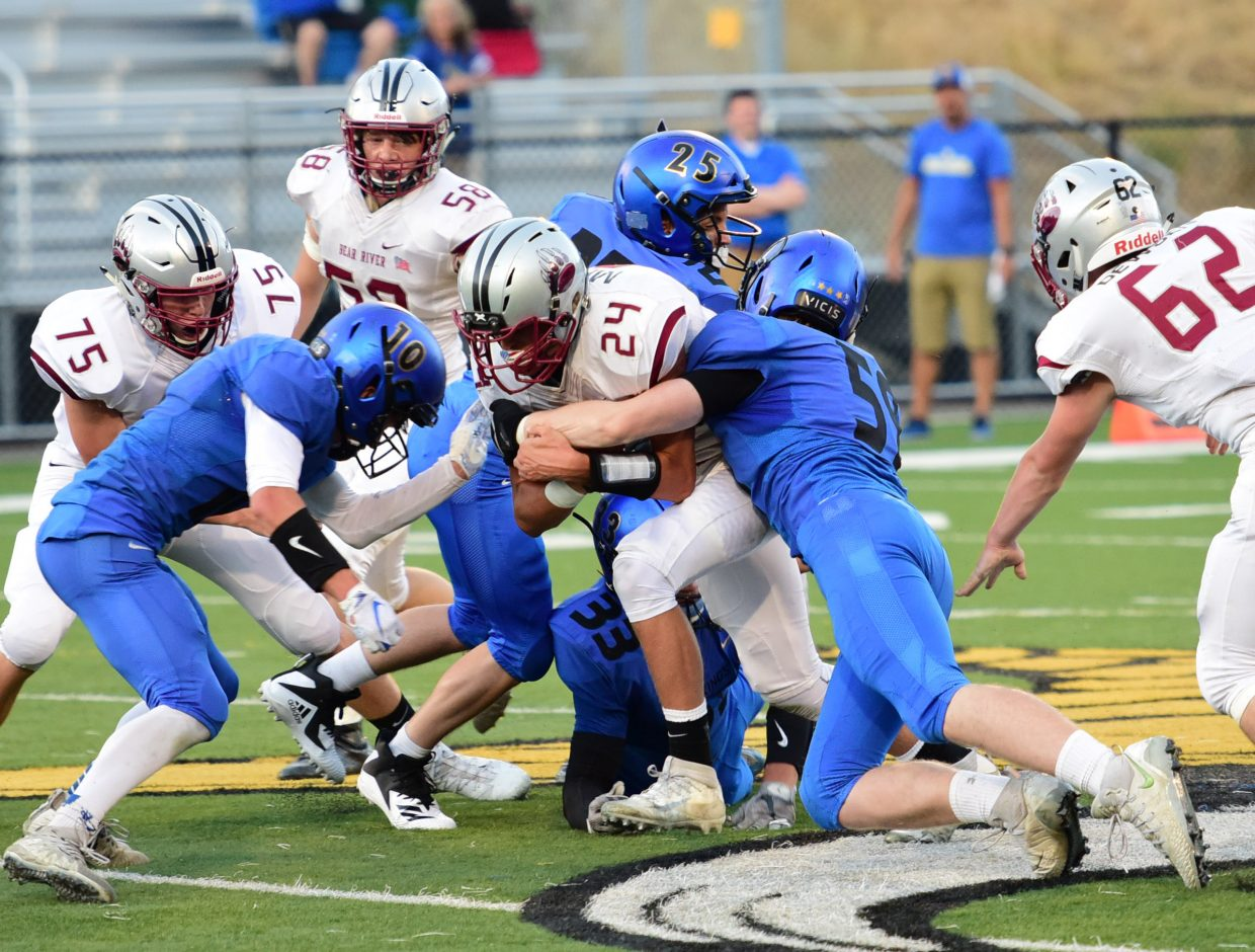 South Tahoe's defense drags down a Bear River ball carrier.