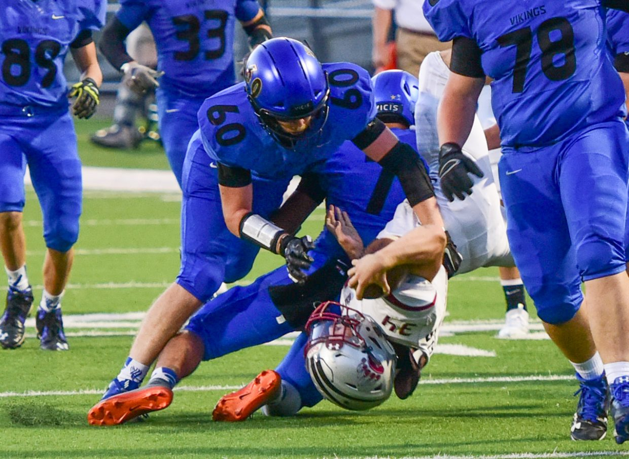 South Tahoe sophomore Cameron Grant brings down A Bear River ball carrier.