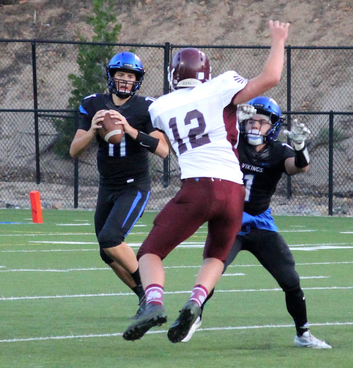 South Tahoe quarterback Jake Tarwater gets blocking help from running back James Knudsen.