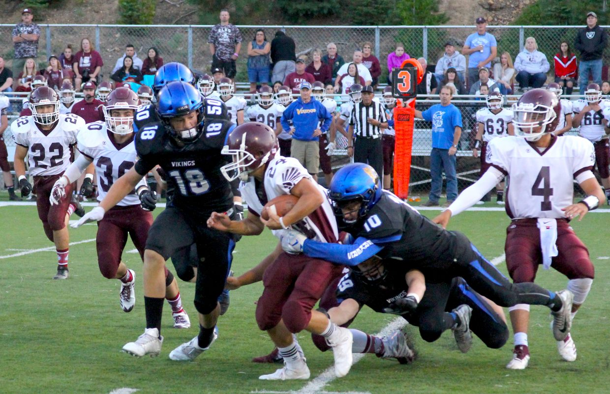The South Tahoe defense gang tackles and Elko ball carrier.