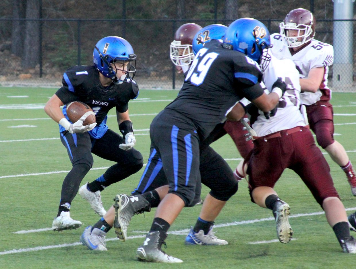 South Tahoe's James Knudsen looks for running room behind the offensive line.