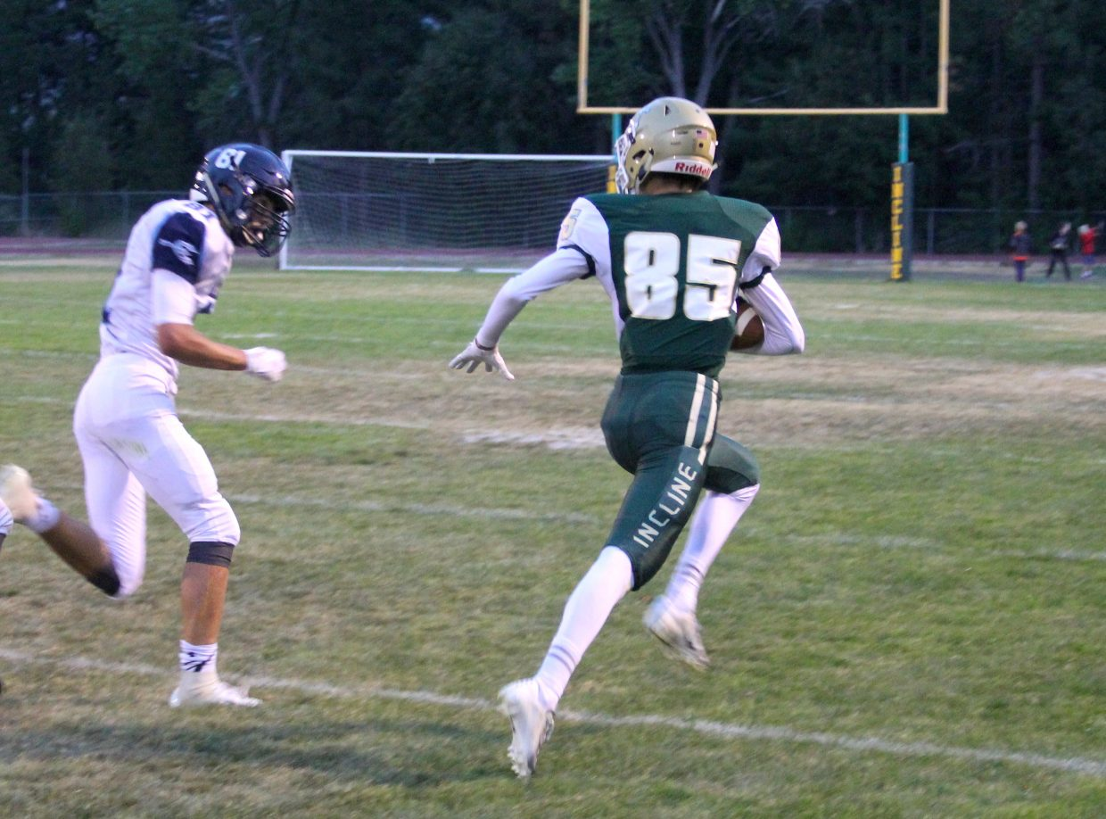 Incline receiver Keenan Collier hauls in a 44-yard reception to set up the Highlanders third touchdown in the first quarter.