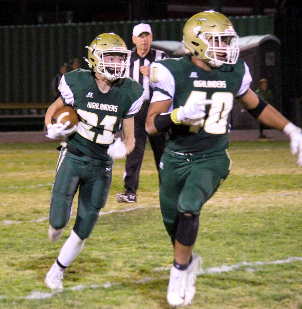 Incline junior Gage Pierce  runs behind the blocking of teammate Marco Barraza. Pierce rushed for a team-high 95 yards on 21 carries.