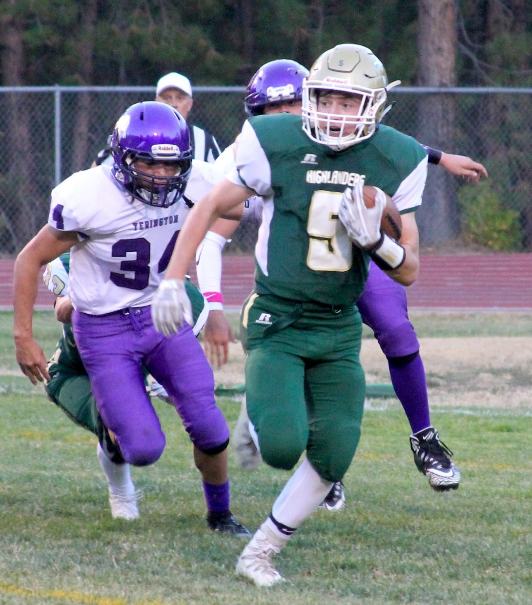 Incline's Brad Rye gains a chunk of yards in the first quarter. The sophomore finished with 95 yards on 13 carries, including an explosive 63-yard scoring run.