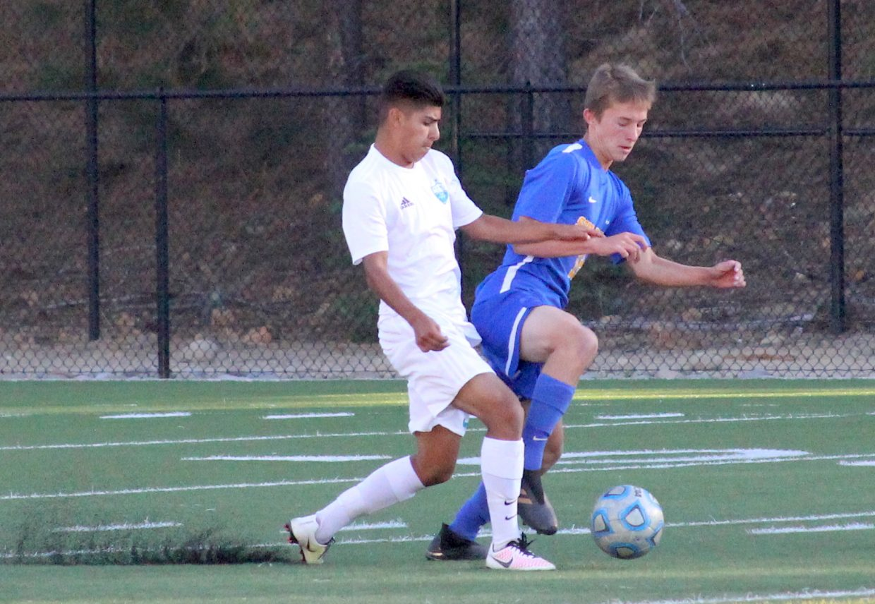 South Tahoe's Oscar Marzocco battles for the ball with a North Valleys defender.