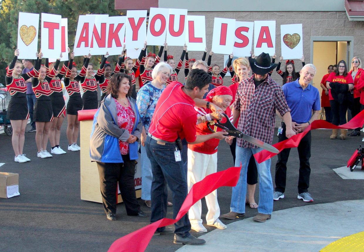 Whittell principal Crespin Esquivel helps Lisa Maloff cut the ribbon to officially open the brand new football field and athletic facility.