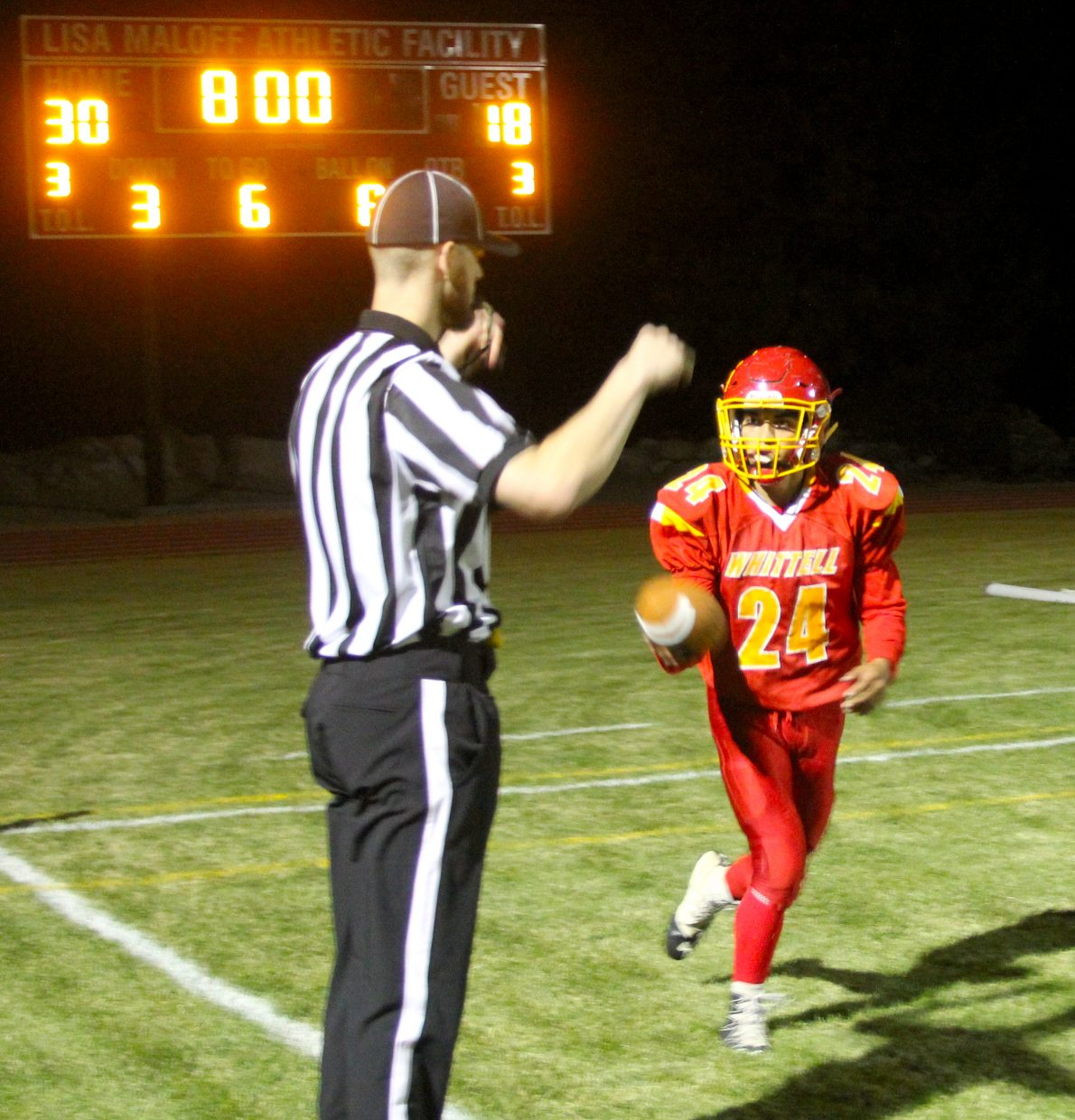 Isaiah Womack tosses the ball to a referee after scoring a third quarter touchdown.