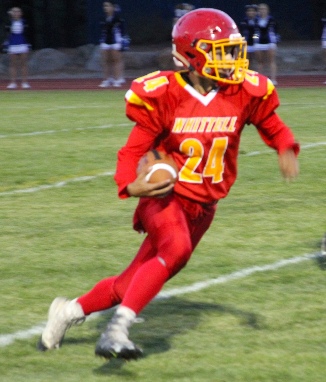 Whittell senior Isaiah Womack runs for a huge gain Friday against Smith Valley.