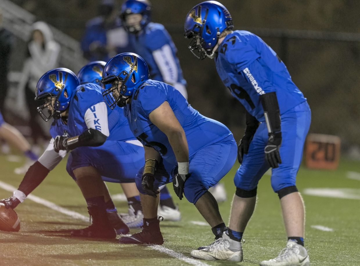 South Tahoe's offensive line prepares for the snap.