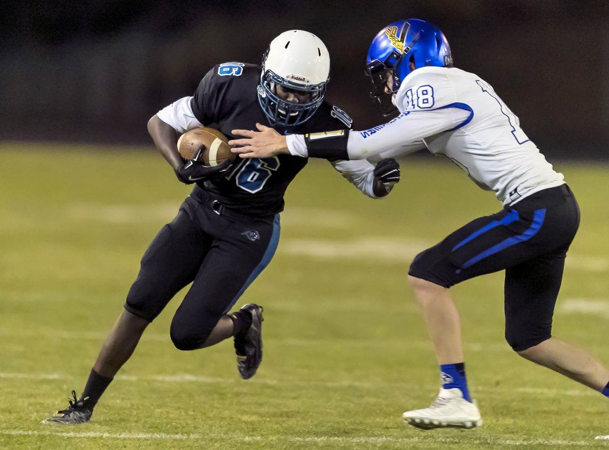 South Tahoe's Drake Lathrop tries to bring down a North Valleys ball carrier Friday night in Reno.