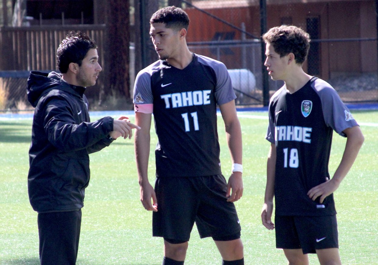 Lake Tahoe Community College head coach Nicholas Arbelaez chats with team captain Jorge Medina (11) and Joel Garcia Friday while playing against Lassen.
