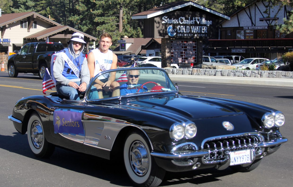 Homecoming royalty parades in a sweet vintage Corvette.