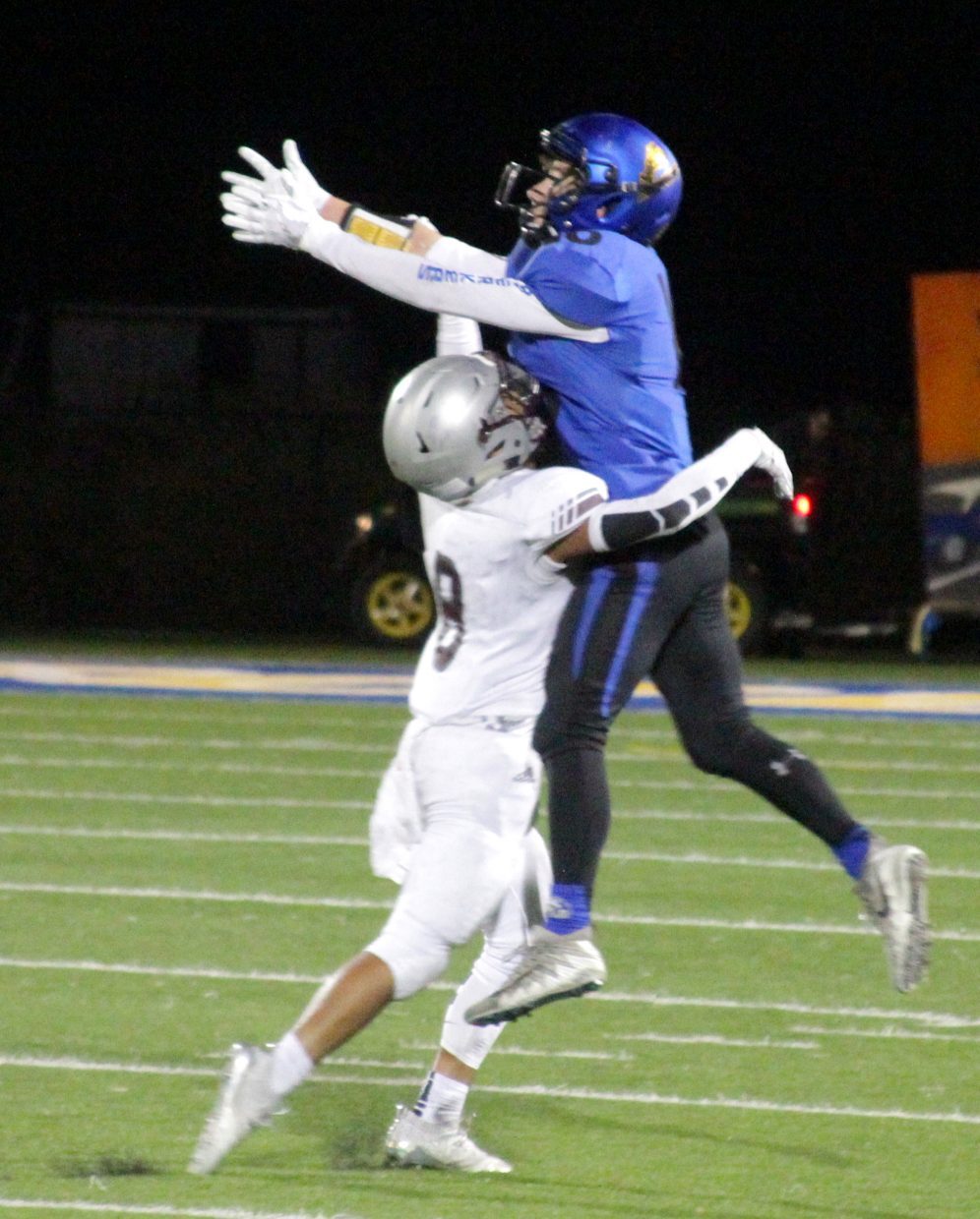 South Tahoe's Kody Griffis goes up for a pass while shielded by a Dayton defender.