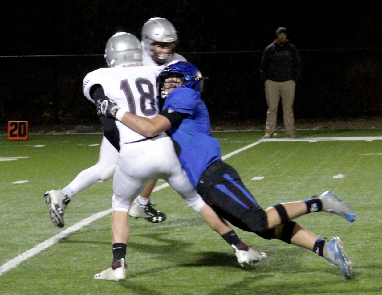 South Tahoe senior linebacker Austin Rhodes smashes Dayton quarterback Justin Schmidt right after he releases the ball.