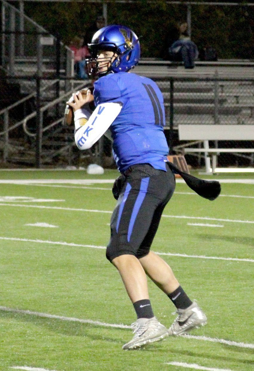 South Tahoe sophomore quarterback Jake Tarwater looks for a receiver.