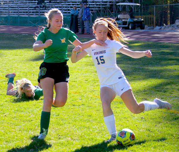 South Tahoe sophomore Kelsey Hogan hits a centering pass Wednesday against Incline.