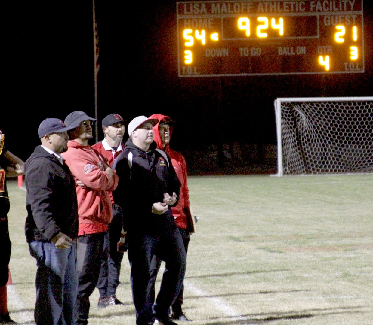 The Whittell coaching staff watches a play in the fourth quarter with the Warriors up big.