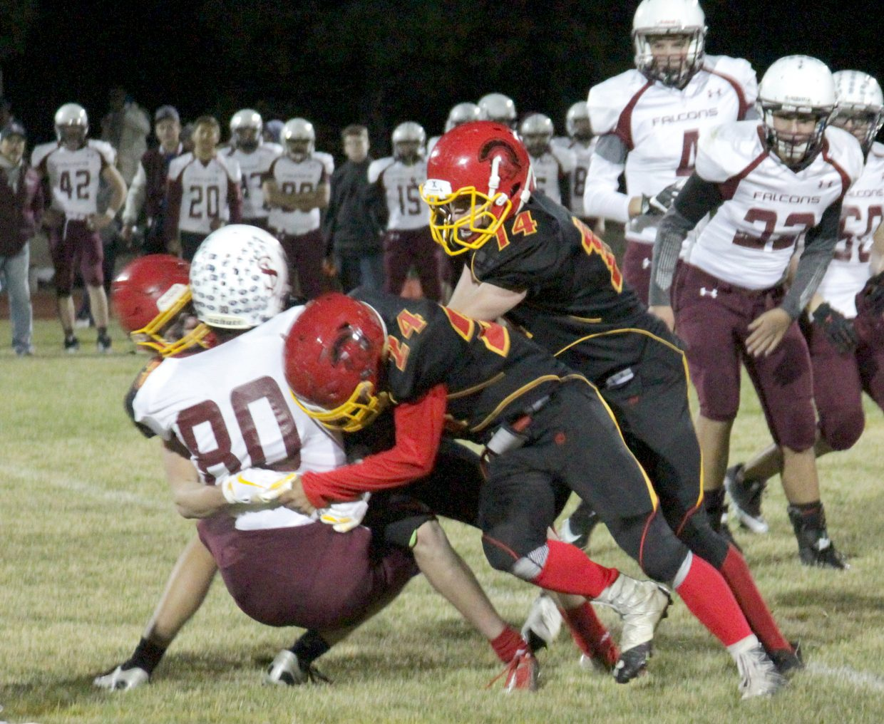 The Whittell defense stuffs Sierra Lutheran's Quinn Cummings Thursday night.