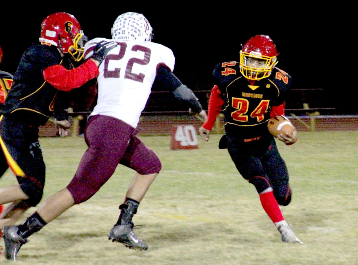 Isaiah Womack runs for some of his 190 yards on Thursday night against Sierra Lutheran.