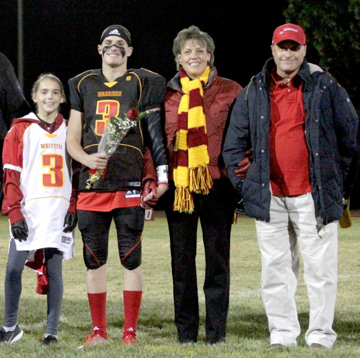 Trent Dingman celebrates senior night with family.