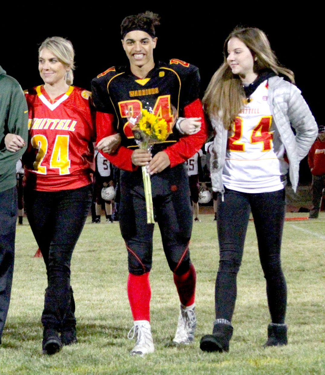 Whittell's Isaiah Womack celebrates senior night with his mom and girlfriend.