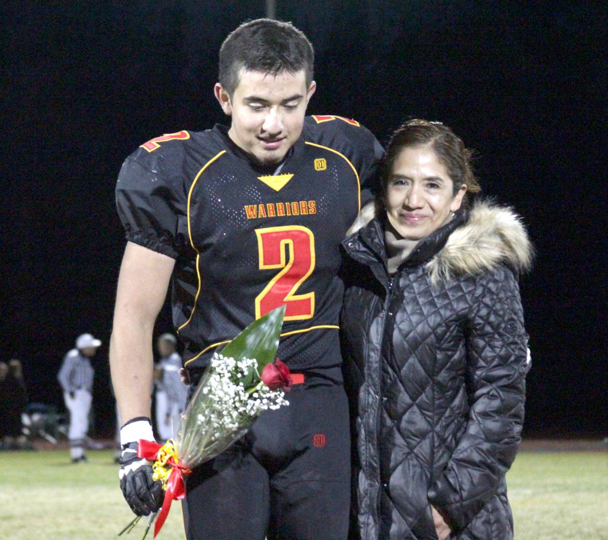 Alexis Gonzales celebrates senior night with his mom.