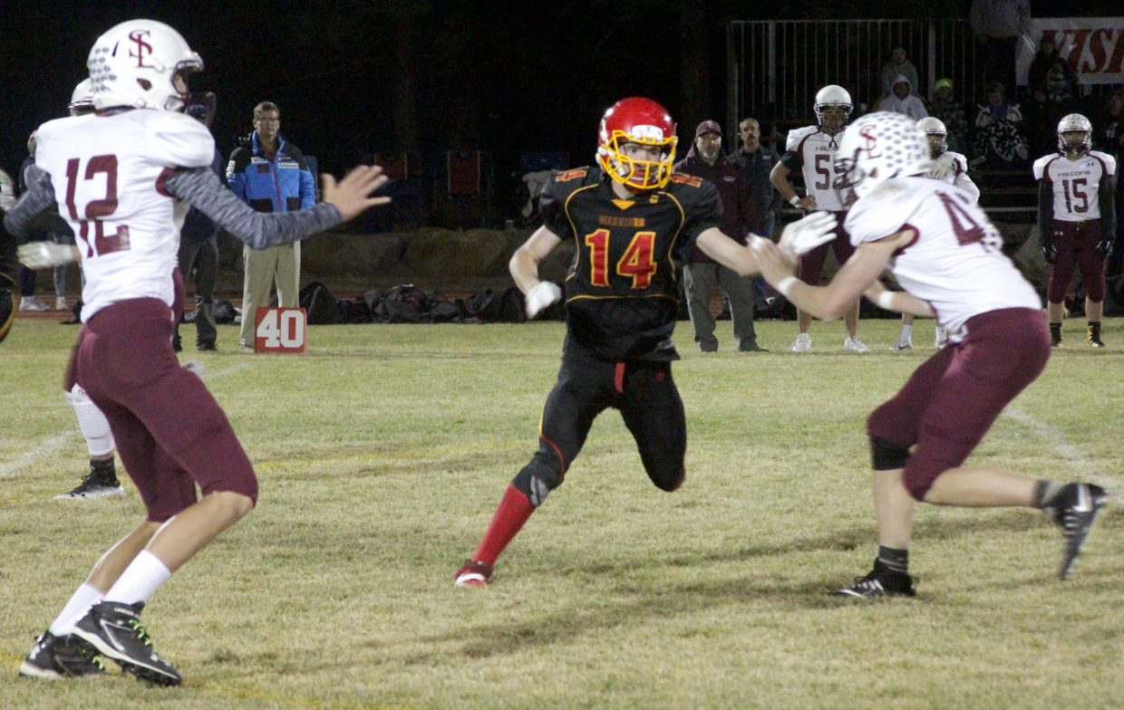 Whittell's Gunnar Barnwell rushes the Sierra Lutheran quarterback.