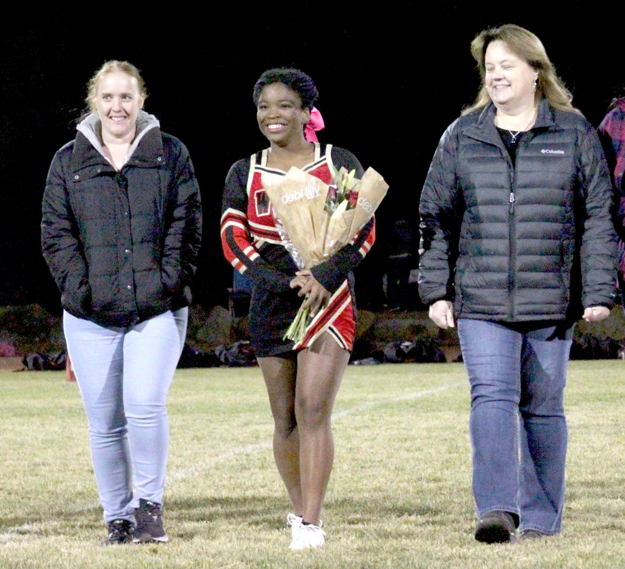 Whittell cheerleader Rebecca Petty celebrates senior night.