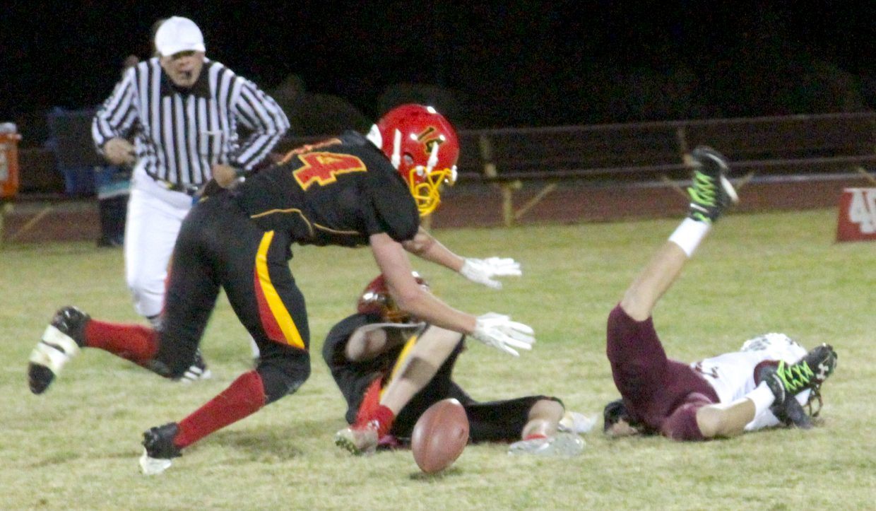 Whittell's Gunnar Barnwell goes for the loose ball after teammate Trent Dingman sacked the quarterback and forced a fumble.