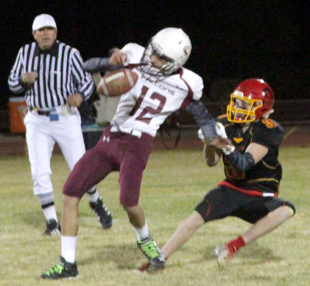 Whittell senior Trent Dingman sacks Sierra Lutheran quarterback Makes Berger and forces a fumble.