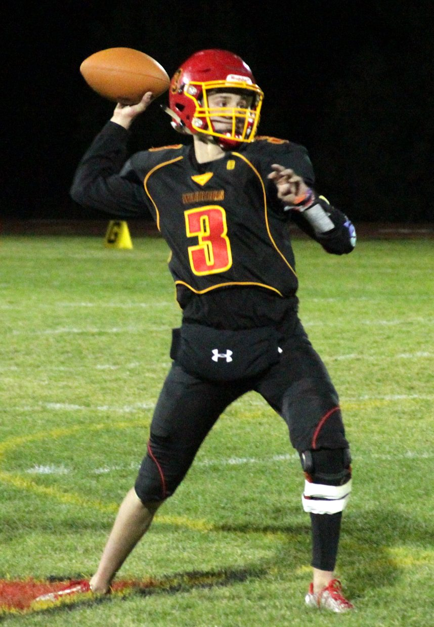 Whittell senior quarterback Trent Dingman fires a pass Friday against Virginia City. Dingman tossed two touchdown passes on the night.