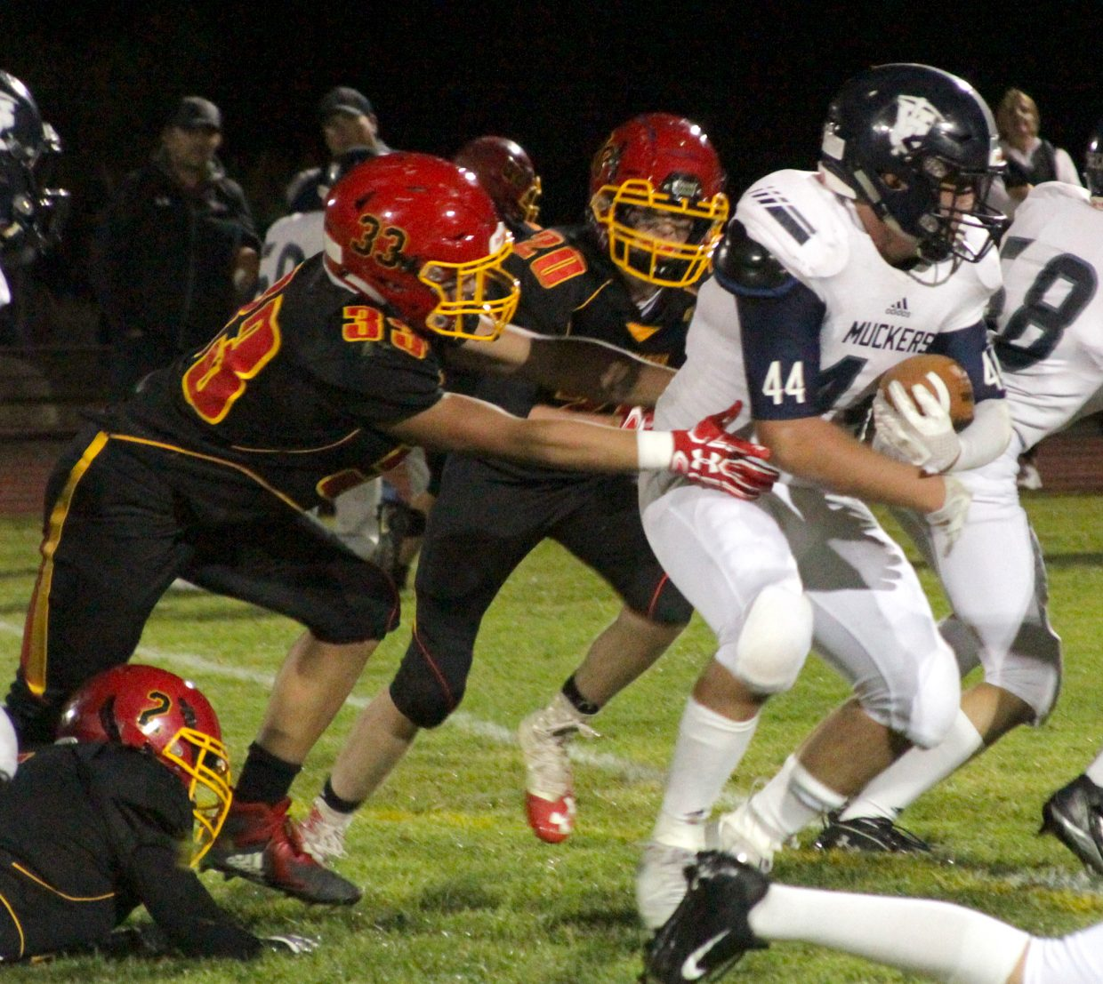 Whittell's DC Nelson (33) and Jack Forvilly (20) try to bring down Virginia City's Tabor Fletcher.
