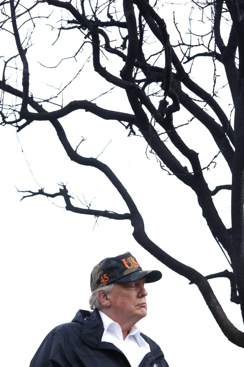 President Donald Trump spends a moment with his thoughts while touring damage from the Woolsey Fire in Malibu, Calif., on Saturday, Nov. 17, 2018. Trump arrived at the oceanside conclave Saturday afternoon after visiting Northern California to survey the wildfire damage in the town of Paradise.