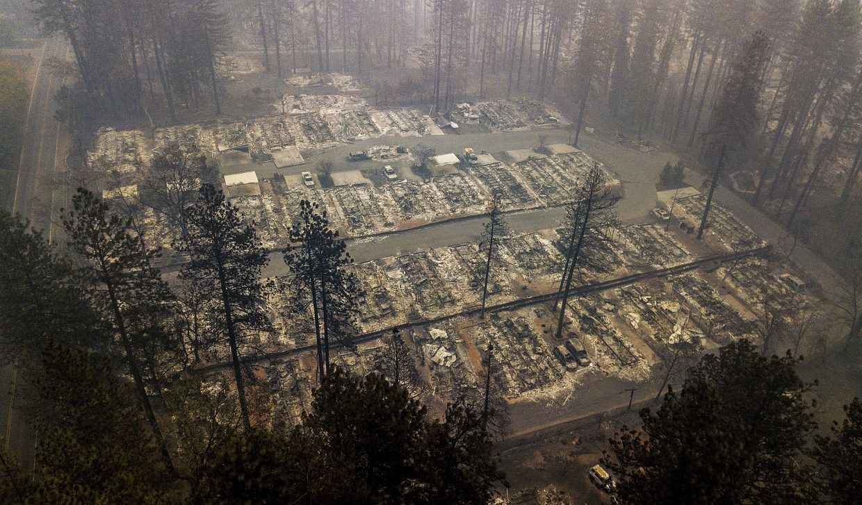 FILE - In this Thursday, Nov. 15, 2018, file photo, residences leveled by the wildfire line a neighborhood in Paradise, Calif. Northern California crews battling the country's deadliest wildfire in a century were bracing for strong winds Sunday, Nov. 18, that could erode gains they have made in containing the fearsome blaze, which has killed dozens and leveled a town.
